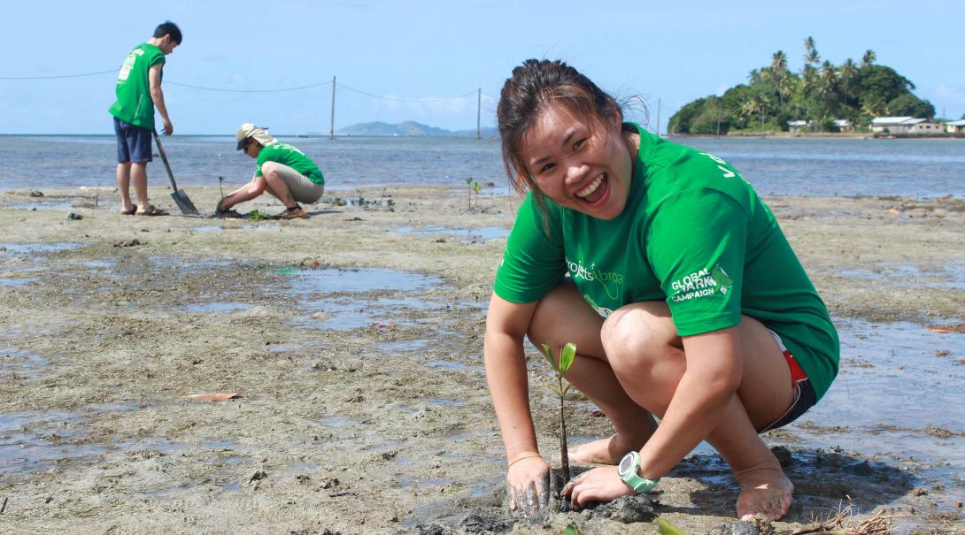 Projects Abroad volunteer plants mangroves as part of her Shark Conservation work in Fiji.